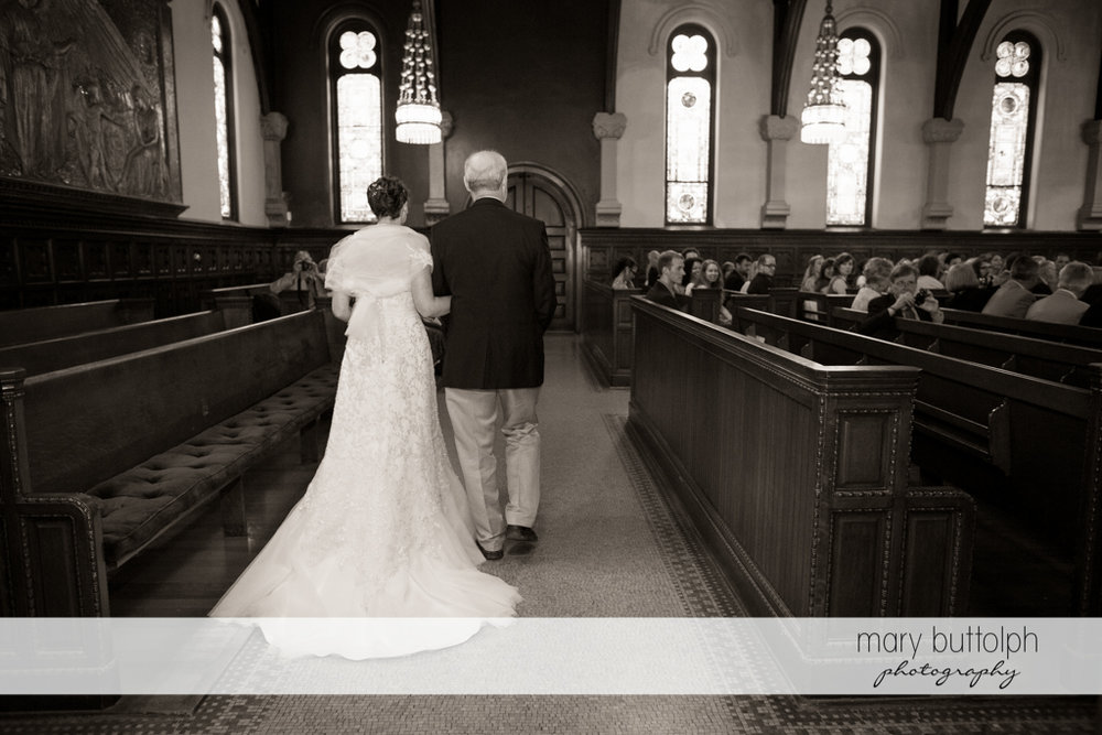 Bride and her father walk down the aisle at the Inns of Aurora Wedding