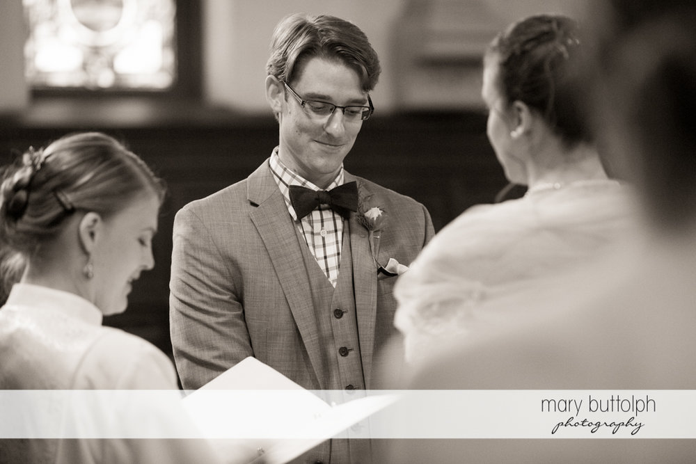 Couple face each other during the wedding ceremony at the inns of Aurora Wedding