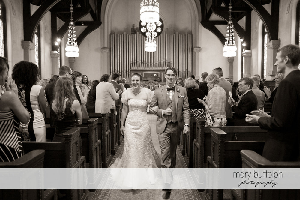 Couple leave church after the wedding at the Inns of Aurora Wedding