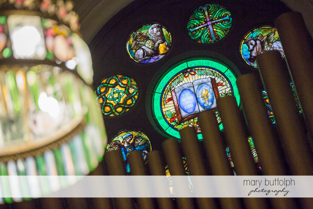 Church's beautiful stained glass windows at the Inns of Aurora Wedding