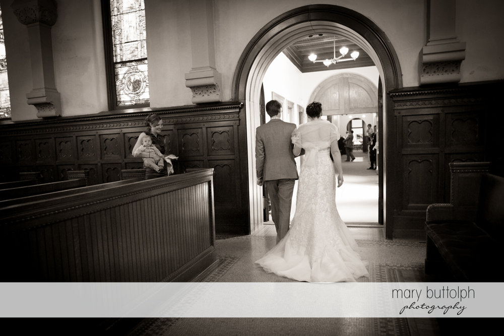 Back view of the newly married couple at the Inns of Aurora Wedding