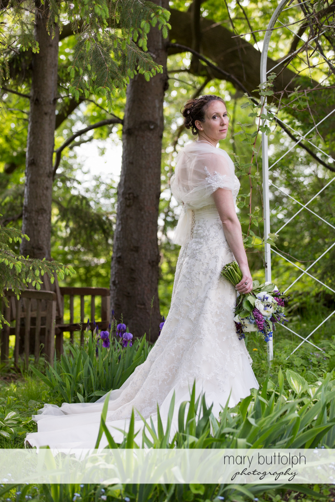 Bride with bouquet in the garden at the Inns of Aurora Wedding