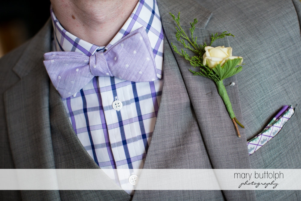 Close up shot of groom's boutonniere at the Inns of Aurora Wedding