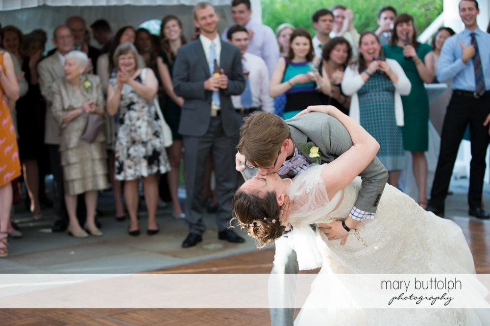 Couple kiss in front of guests at the Inns of Aurora Wedding
