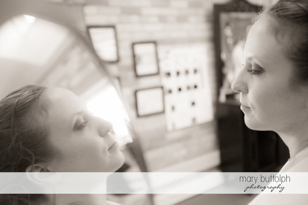 Bride sees her reflection in the mirror at the Inns of Aurora Wedding