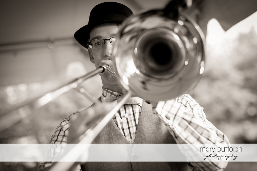 Groom plays the trumpet at the Inns of Aurora Wedding