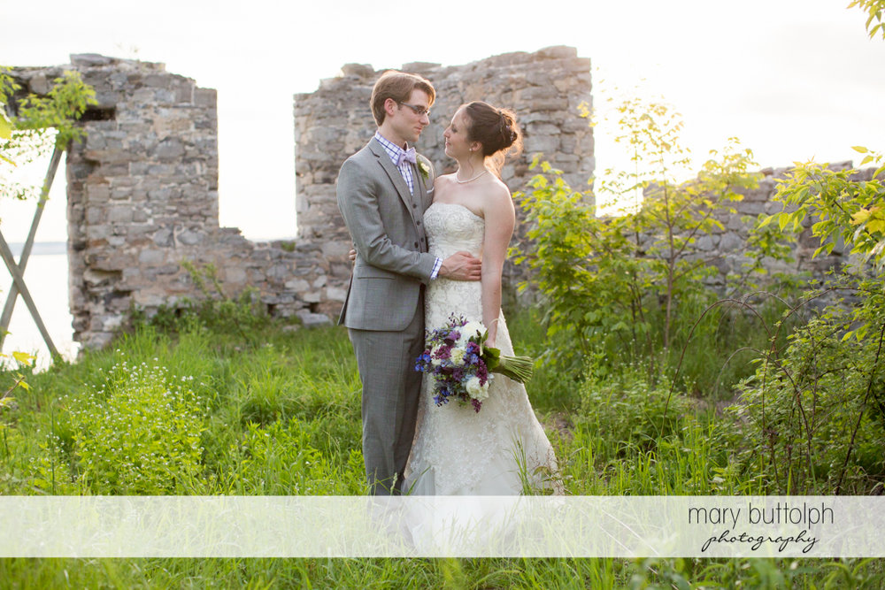 Couple spend a quiet time near the ruins at the Inns of Aurora Wedding