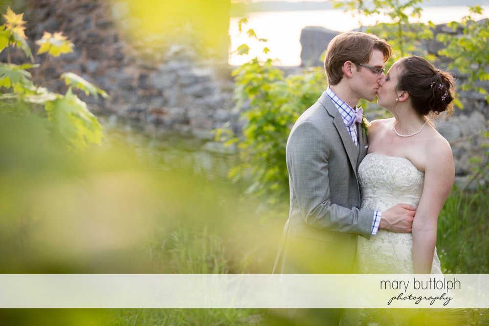 Couple share a tender moment in the ruins at the Inns of Aurora Wedding