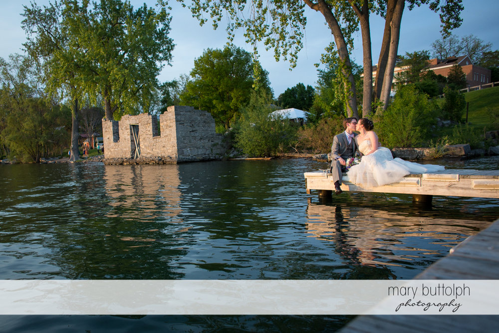 Couple get romantic by the lake at the Inns of Aurora Wedding