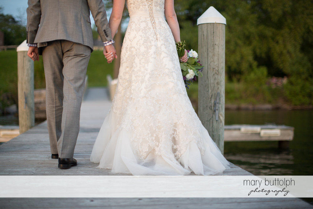 Couple leave the docks at the Inns of Aurora Wedding