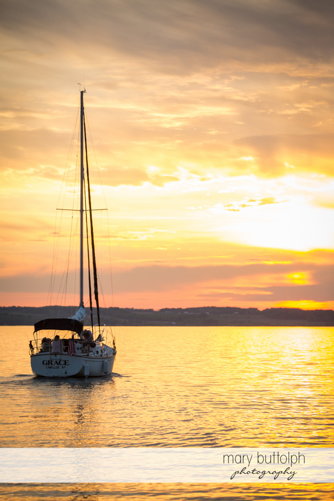 Boat sails to the sunset at the Inns of Aurora Wedding