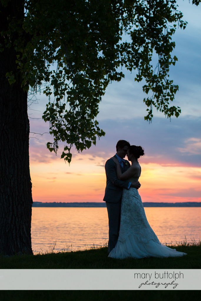 Couple catch the sunset by the lake at the Inns of Aurora Wedding