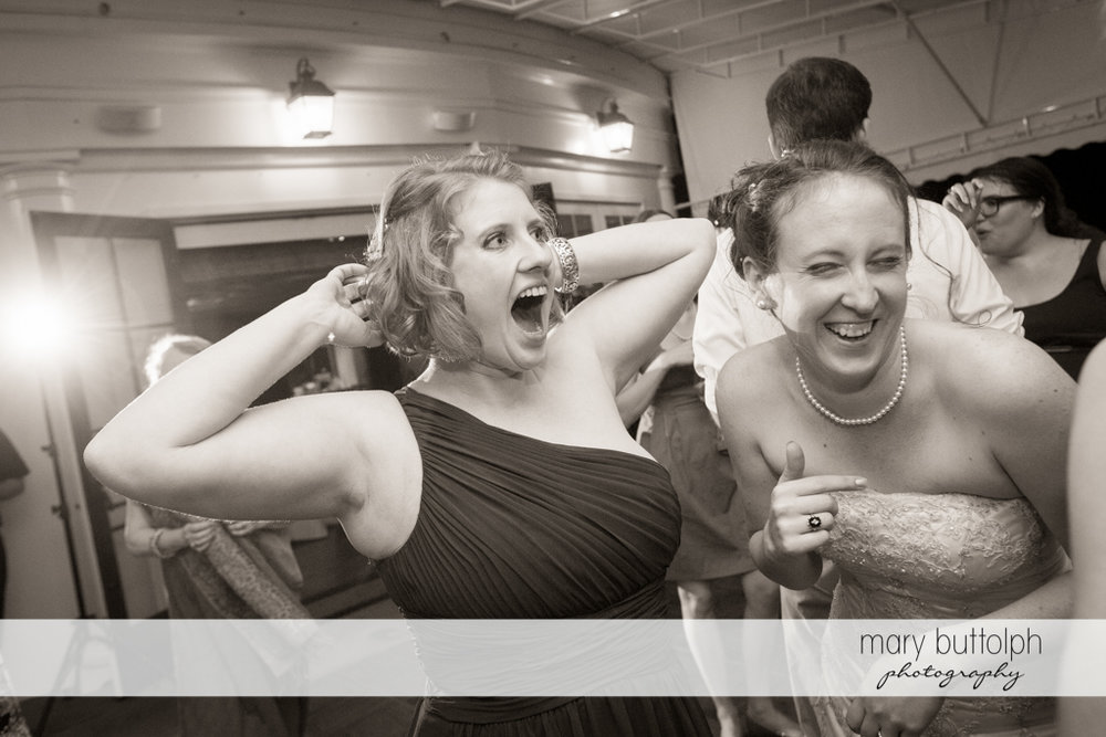 Bride and bridesmaid light up the dance floor at the Inns of Aurora Wedding