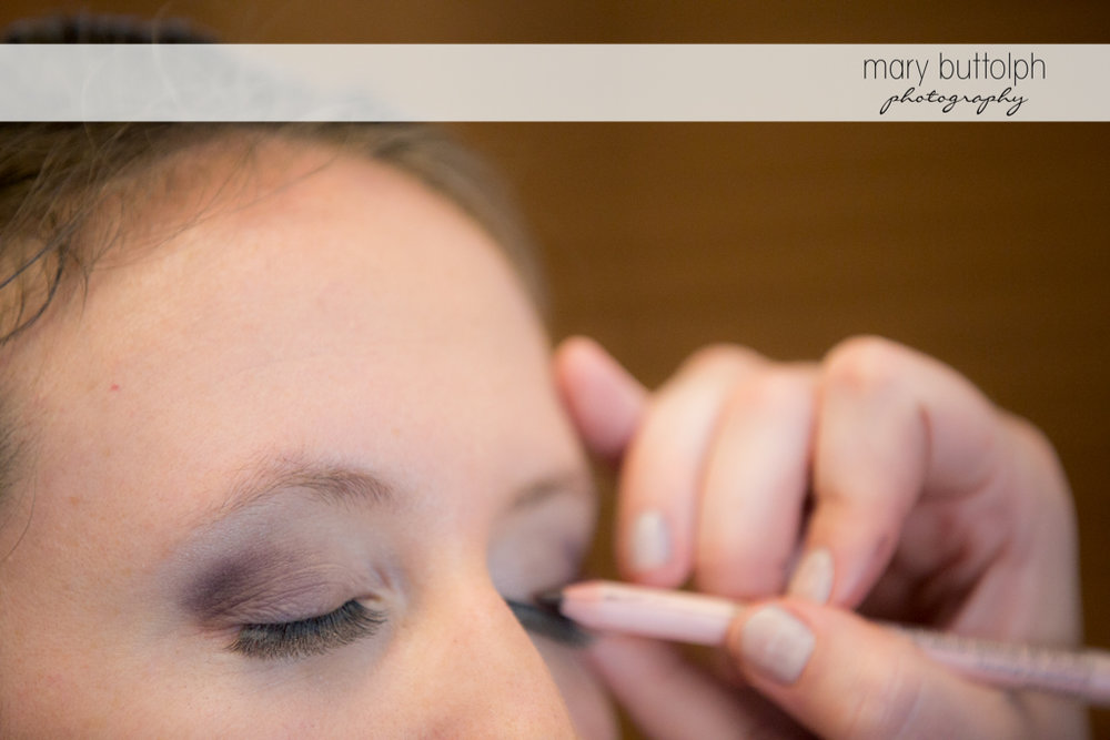 Makeup artist applies eye shadow on the bride at the Inns of Aurora Wedding