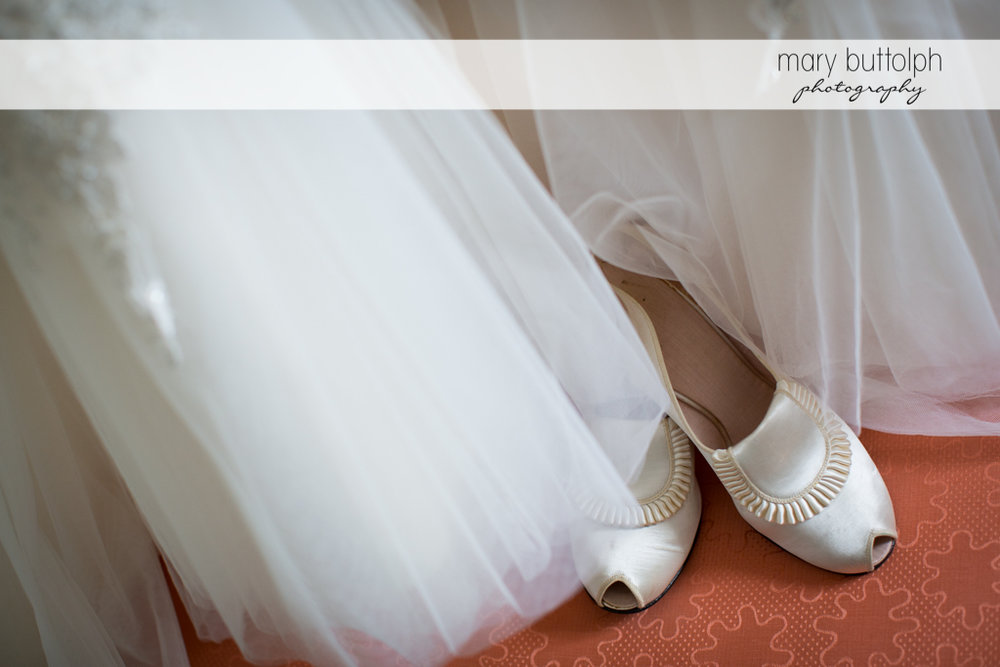 Bride's wedding dress and wedding shoes at the Inns of Aurora Wedding