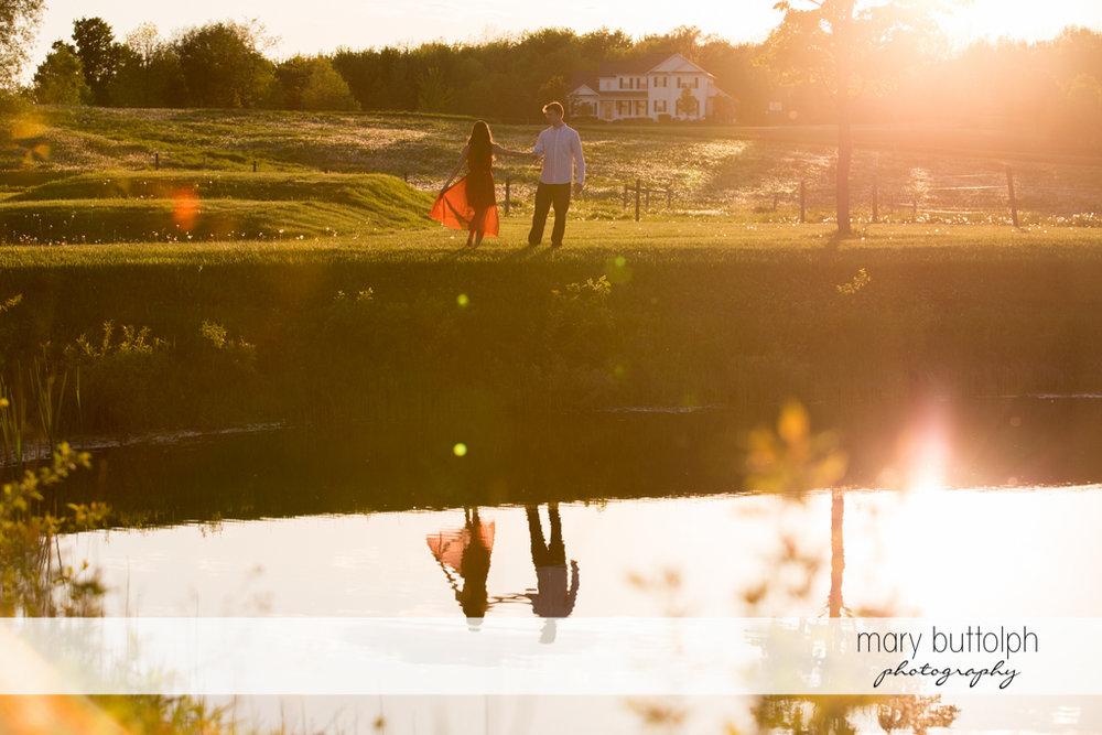 Couple take a break near the lake at Skaneateles Engagement
