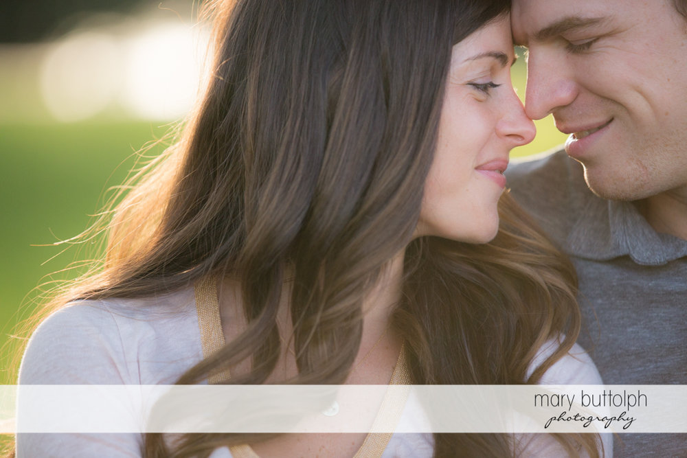 Couple rub noses in a close up shot at Skaneateles Engagement