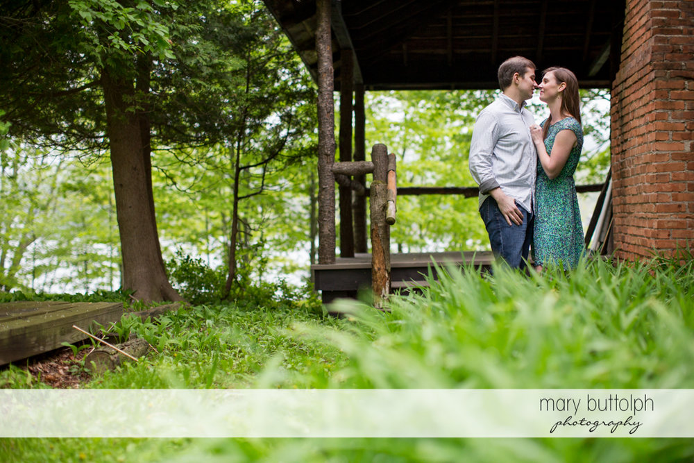 Couple stand near an old house at the Hamilton Inn Engagement