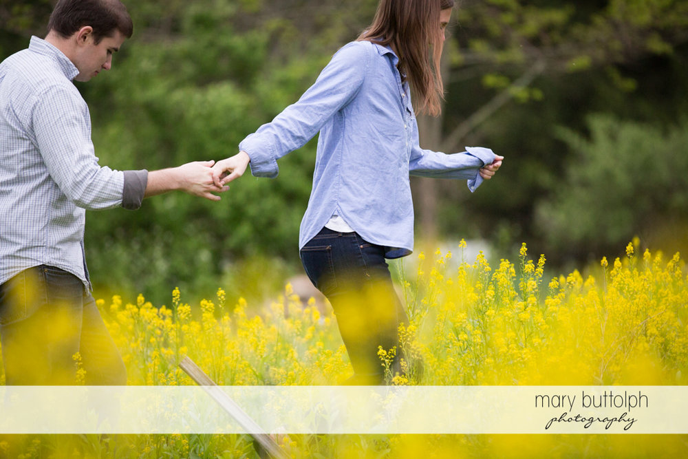 Couple stroll in the garden at the Hamilton Inn Engagement