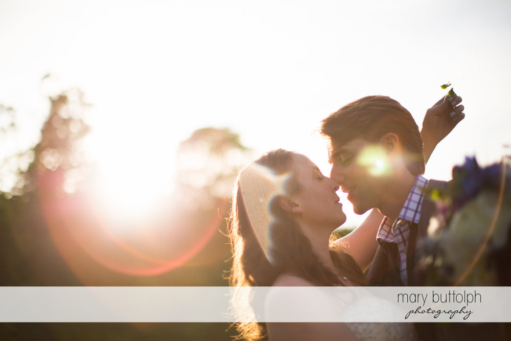 Couple kiss under the sun at Taughannock Falls Wedding