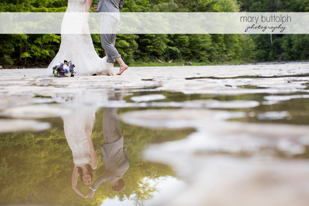 Couple's reflection appears in the lake at Taughannock Falls Wedding