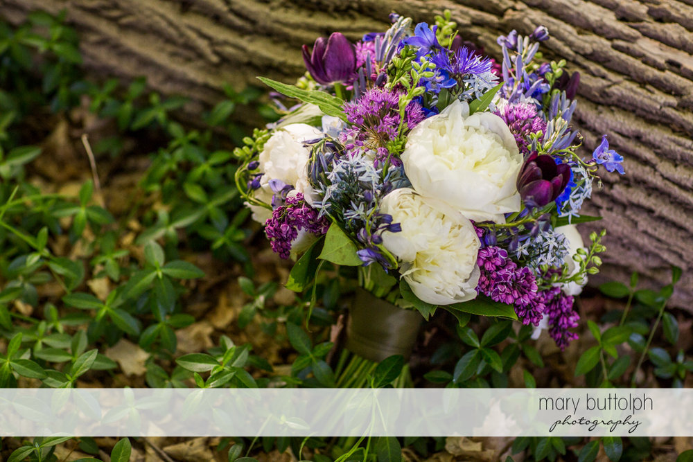 Bride's beautiful bouquet in the woods at Taughannock Falls Wedding