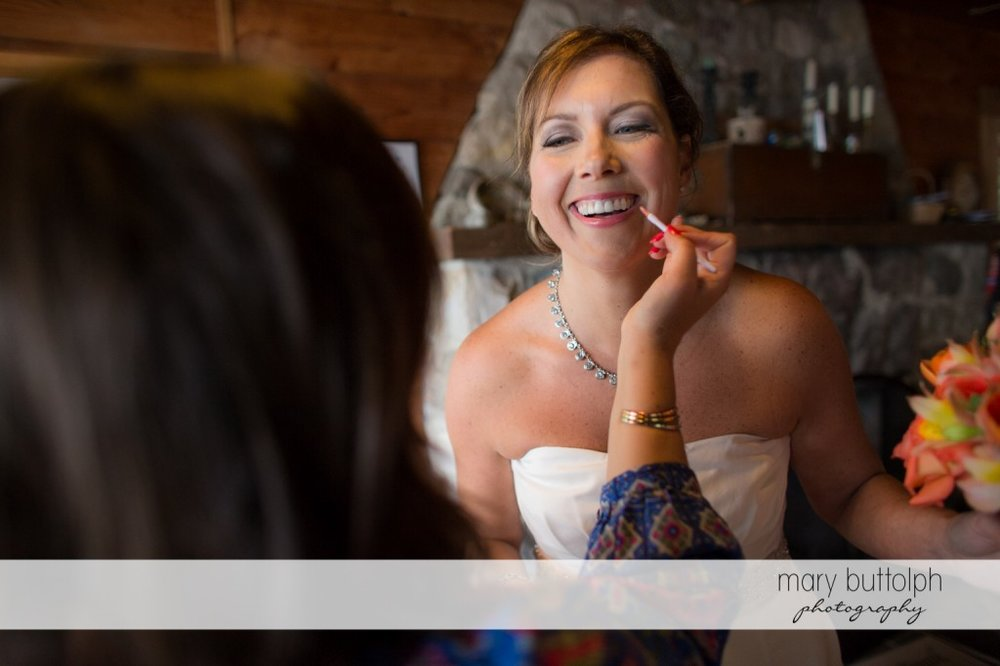 Smiling bride gets a makeover at Skaneateles Country Club Wedding