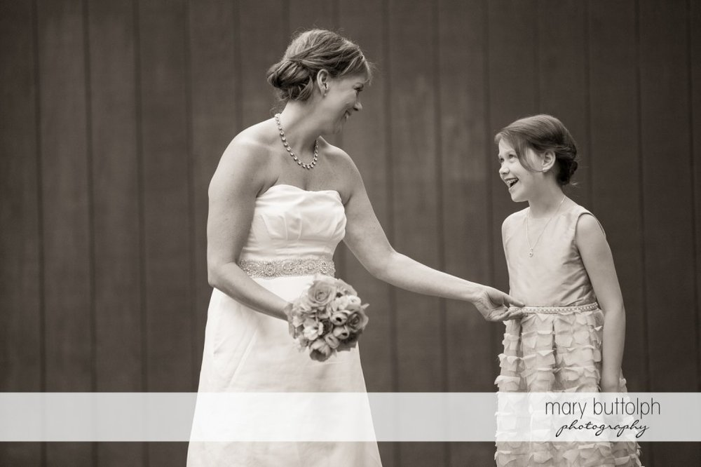 Bride and young girl share a happy moment at Skaneateles Country Club Wedding