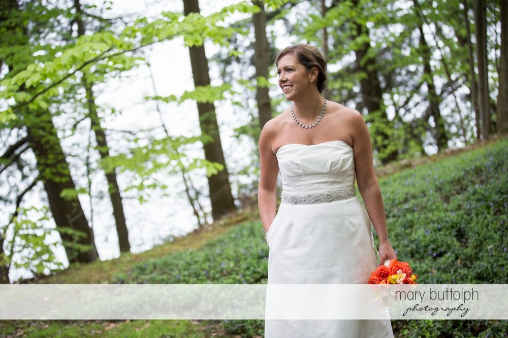 Bride in the woods at Skaneateles Country Club Wedding