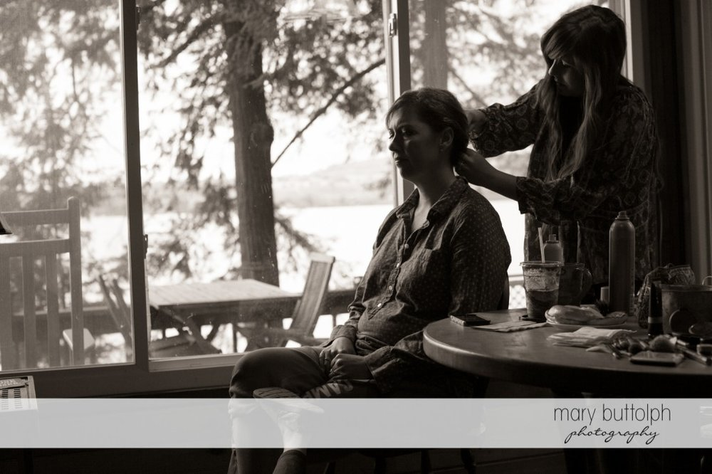 Bride gets her hair done for the big day at Skaneateles Country Club Wedding