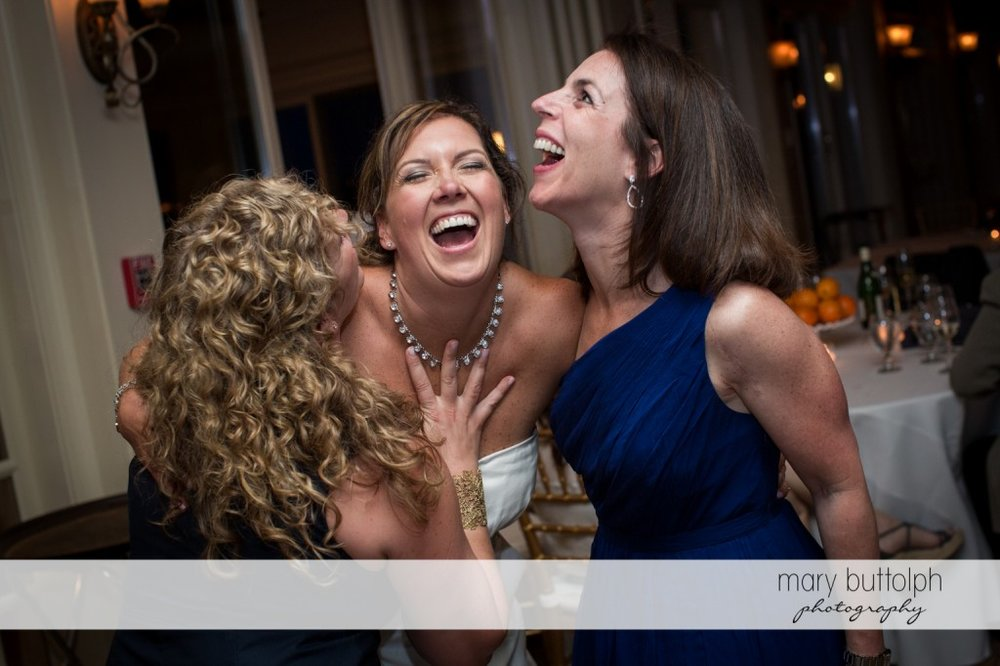 Bride and her guests can't control their laughter at Skaneateles Country Club Wedding