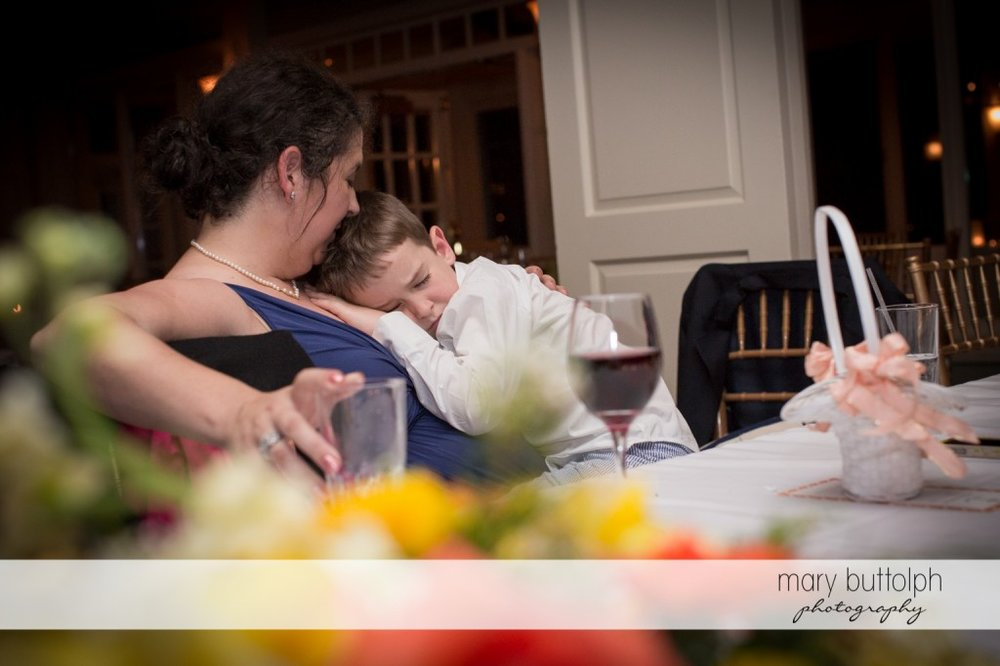 Young boy is too tired to party at Skaneateles Country Club Wedding