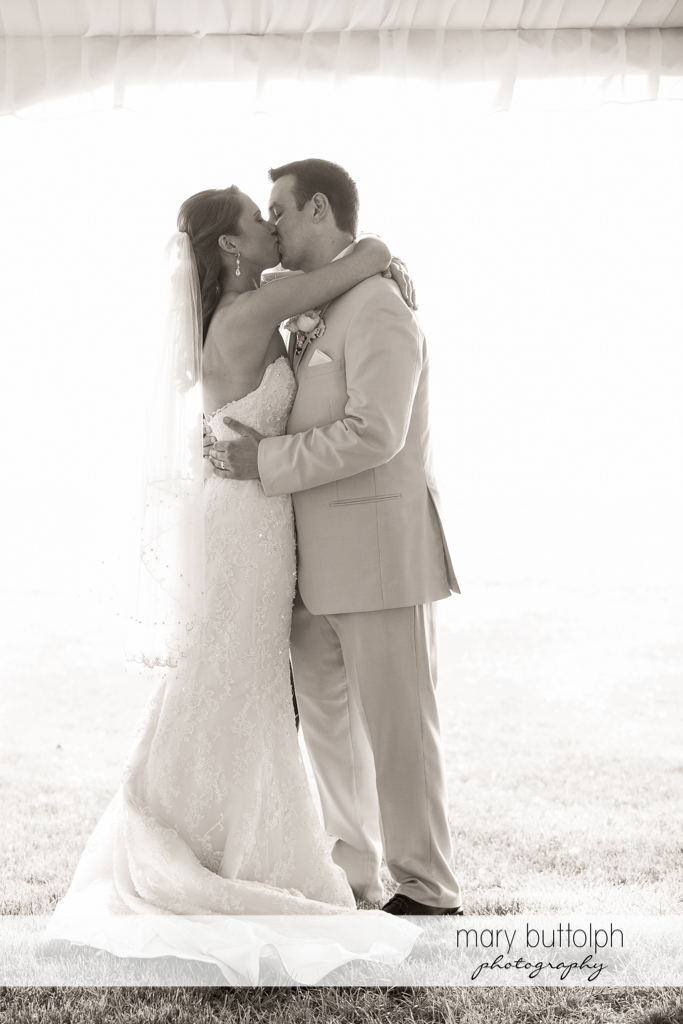 Couple kiss after the wedding at the Inns of Aurora Wedding