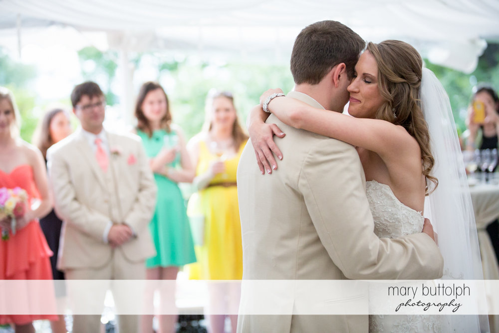Couple dance as guests look on at the Inns of Aurora Wedding
