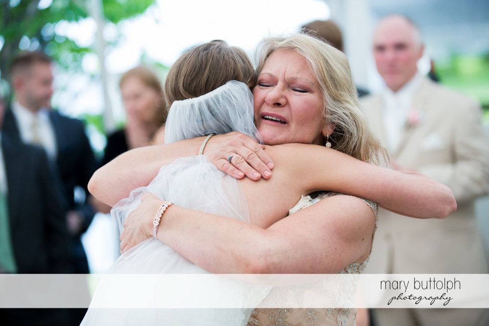 Bride hugs her mother at the Inns of Aurora Wedding