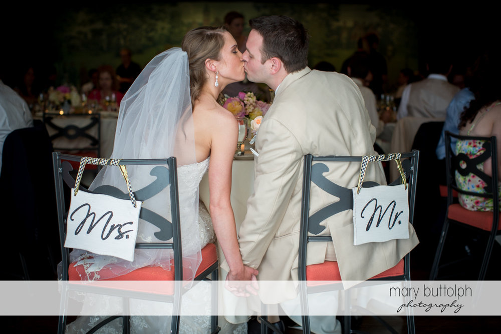 Couple kiss at the wedding venue at the Inns of Aurora Wedding