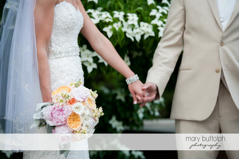 Another shot of the couple holding hands in the garden at the Inns of Aurora Wedding