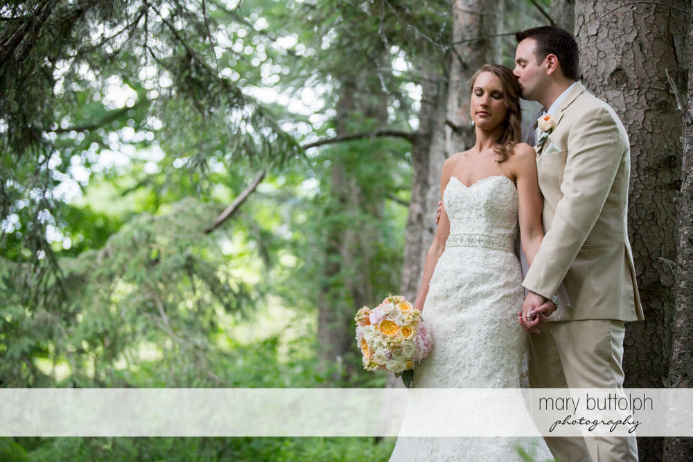 Couple spend a quiet moment in the woods at the Inns of Aurora Wedding