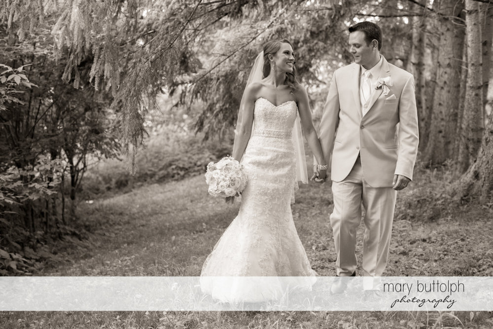 Couple stroll in the woods at the Inns of Aurora Wedding