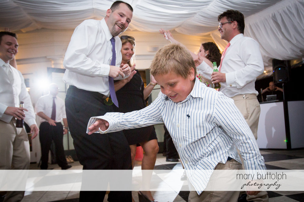Young boy shines on the dance floor at the Inns of Aurora Wedding