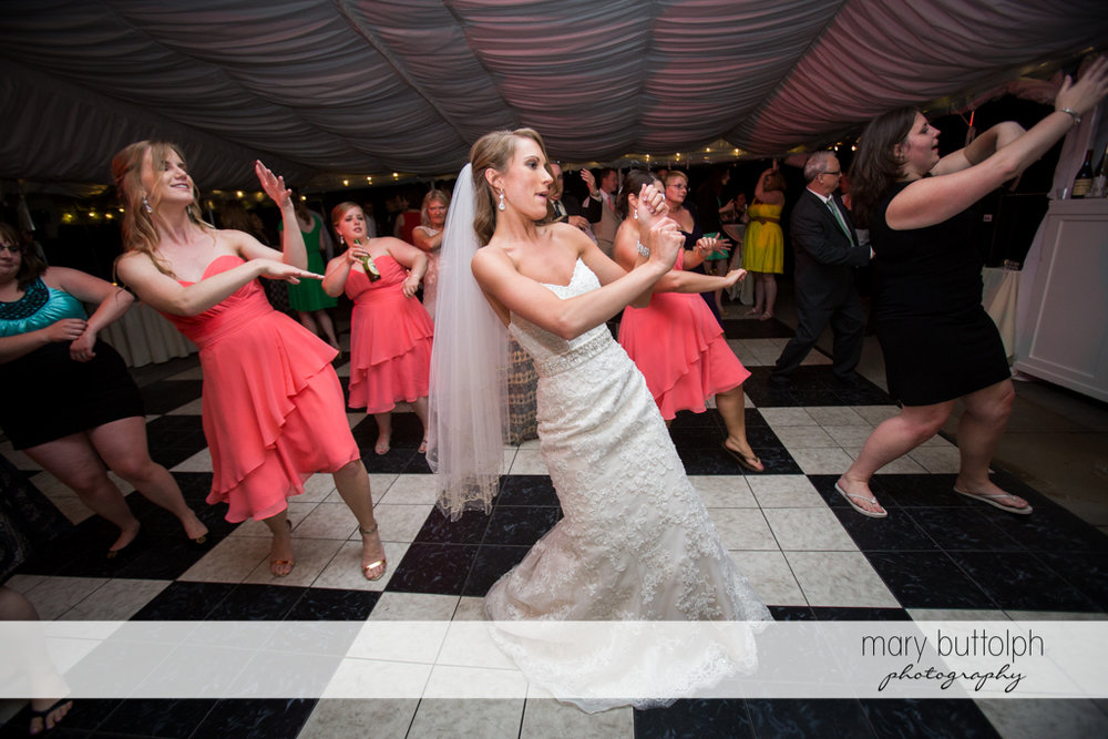 Bride dances with guests at the Inns of Aurora Wedding