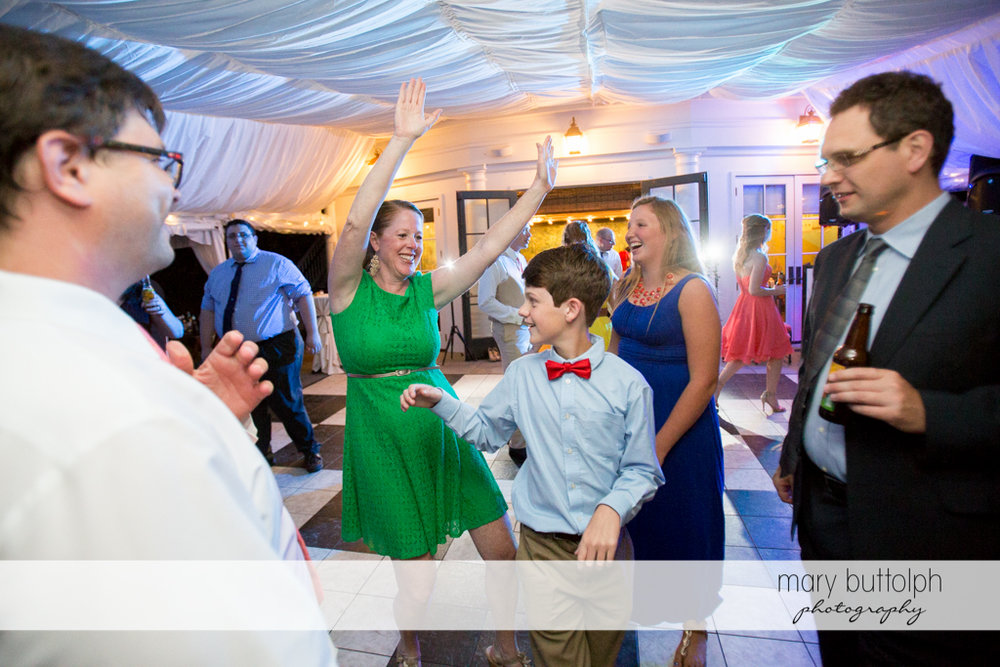 Young man joins other guests on the dance floor at the Inns of Aurora Wedding