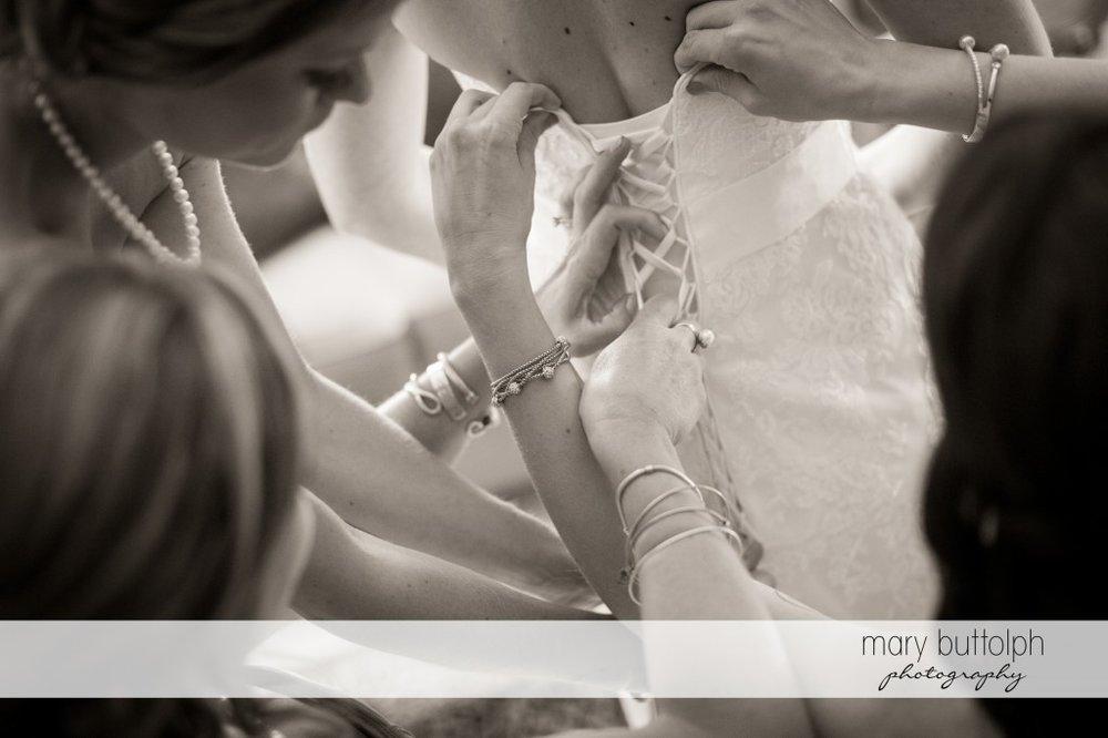 Bridesmaids adjust bride's wedding dress at Emerson Park Pavilion Wedding
