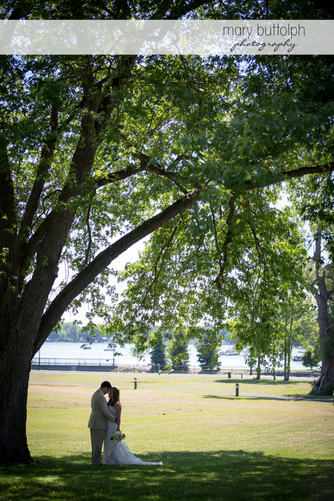 Couple rub noses under a big tree at Emerson Park Pavilion Wedding