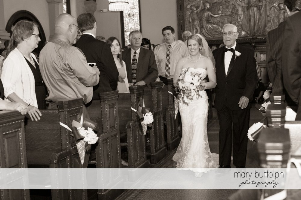 Bride and her father walk down the aisle as guests look on at Emerson Park Pavilion Wedding