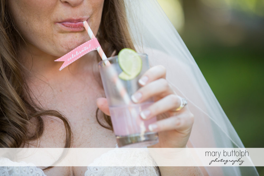 Bride stays cool with the help of pink lemonade at Emerson Park Pavilion Wedding