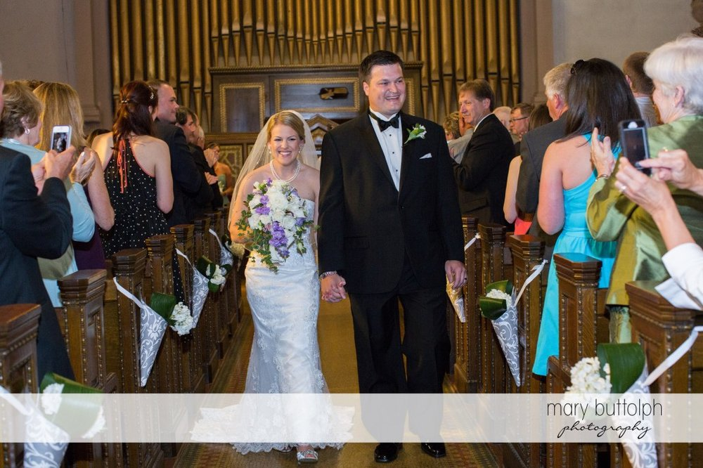 Couple leave the church after the wedding at Emerson Park Pavilion Wedding