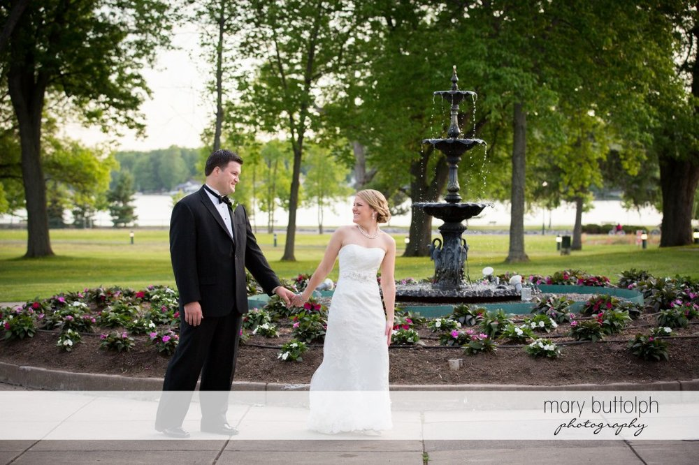Another great shot of the happy couple in front of the iconic fountain at Emerson Park Pavilion Wedding