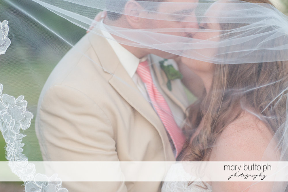 Close up shot of the kissing couple behind the bride's wedding veil at Emerson Park Pavilion Wedding