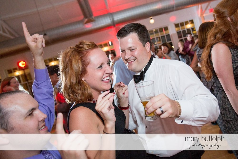Groom and guests have a great time on the dance floor at Emerson Park Pavilion Wedding